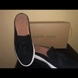 Black suede slides with tassels by Gentle Souls